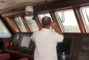 Captain Kostas Andreeou on the bridge as Allure Shadow approaches Dominica