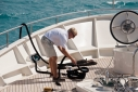 Deckhand preparing a rope on the foredeck of Big Aron