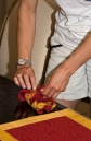 Steardess arranging napkins for dinner in dining room aboard MY Solemates