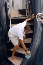 "Deckhand cleaning aboard ""Sea Shell II"""