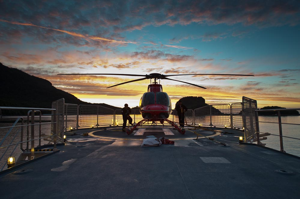 Tying down Atmosphere's helicopter at sunset from aboard Atmoshpere in Auchemo