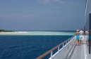 Two guests aboard Island Explorer look out at Oluhali, a desserted island