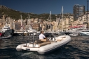 Yachts on the dock at the Monaco yacht show from the water