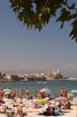 View across Plage du Ponteil to Le Vieil Antibes and yachts in the anchorage