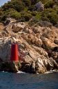 Port hand beacon at entrance to Porto Cervo