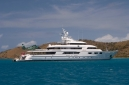 """Motor yacht """"Floridian"""" with her helicopter at anchor in North Sound"""