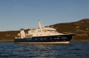 Hanse Explorer at anchor off Holy Island from forward quarter