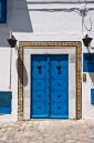 Traditional blue painted studded wooden door in Sidi Bou Said