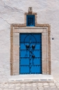 Traditional blue painted wooden door in Sidi Bou Said