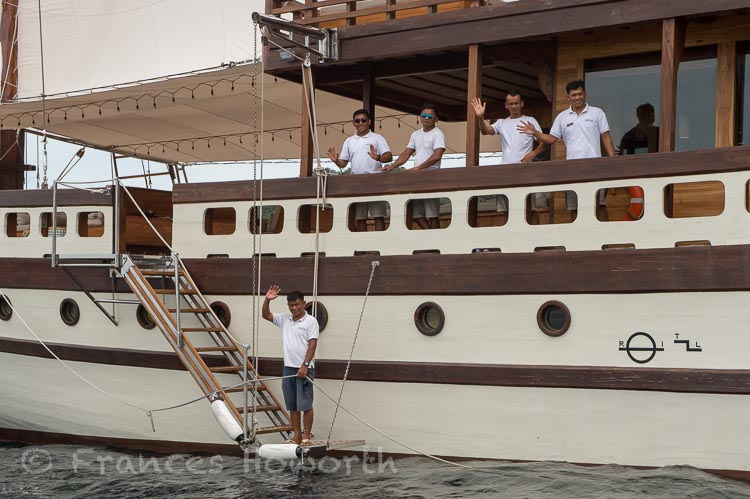 Crew greeting dinghy on arrival at Prana by Atzaro